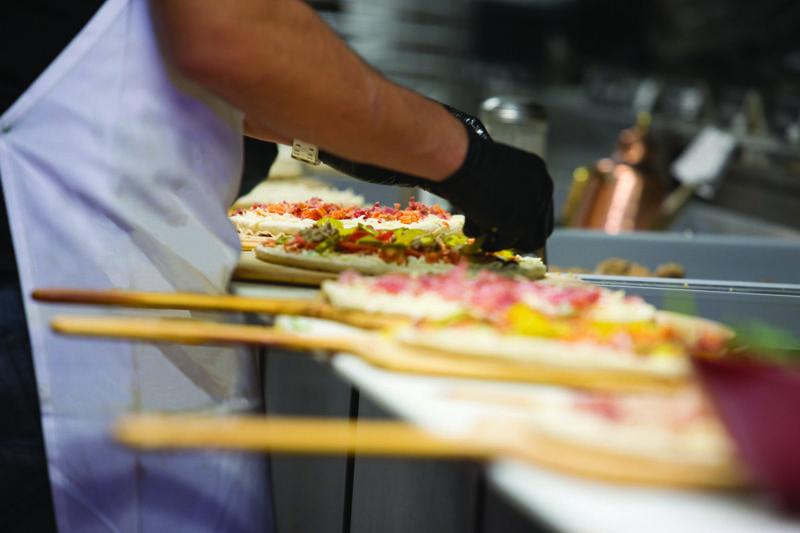 Firo pizzas being prepared by a Firo-ista