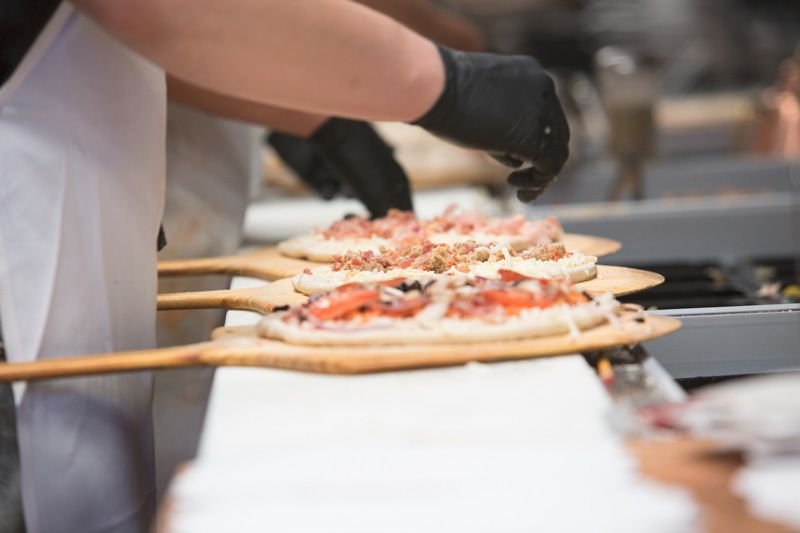 Firo pizzas being prepared by a Firo-ista